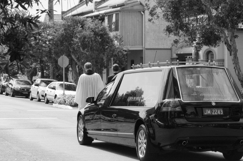 Funeral car leaving St John's Church, Cooks Hill
